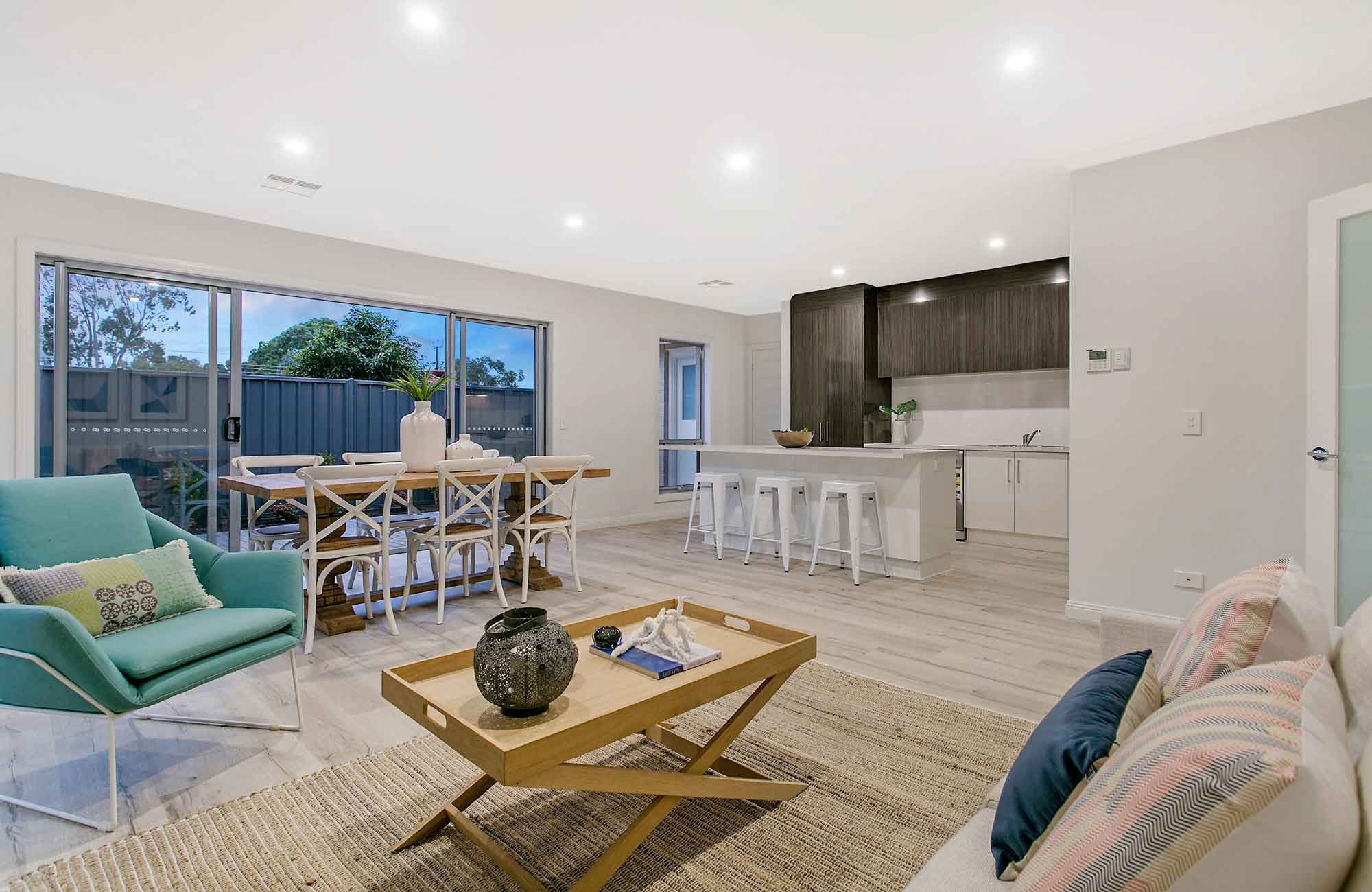 large living area flowing into modern kitchen